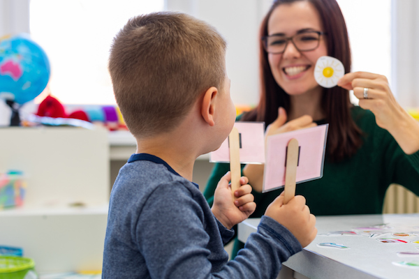 Child working on articulation with a speech therapist