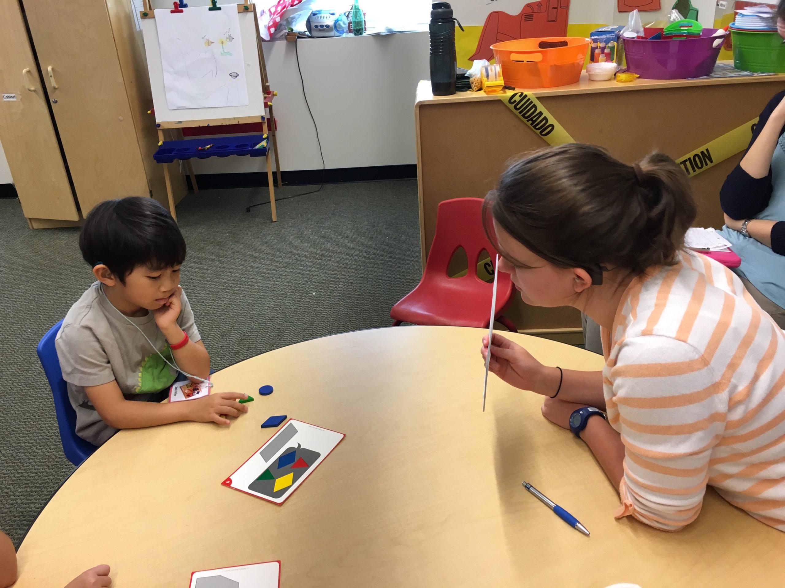 Speech therapist evaluating pediatric client