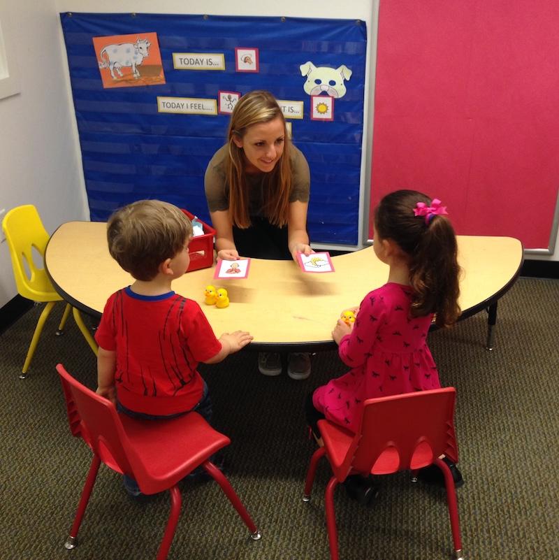 Speech language pathologist conducting pediatric client therapy